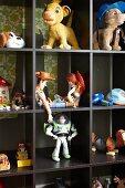 Toy figurines in dark wooden display case