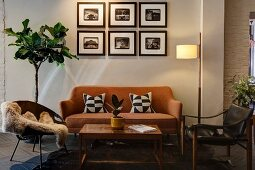Fifties-style lounge furniture with black and white patterned scatter cushions, gallery of pictures and standard lamp