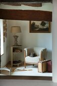 Armchair, corner side table and vintage suitcases