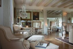 Country house with pale period furniture, Rococo armchairs with footstools and transparent partition made from vertical wooden rods