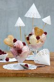 Ice-cream sundae with decorated with parasols hand-made from white doilies