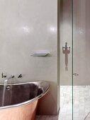 Retro, industrial-style designer bathtub and walk-in shower with polished, glazed walls