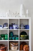 Crockery and china painted blue and white on white shelves