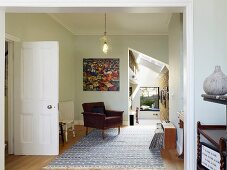 Open-plan interior in restored, extended terrace house with historical ambiance