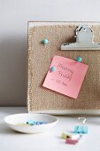 Note of meeting appointment pinned to pinboard