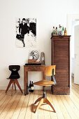 Small work area with wooden table, chairs and old filing cabinet