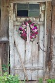 Wreath of Sweet William on rustic board door