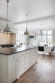 Country-house kitchen with wooden ceiling and dining table