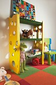 DIY shelving in child's bedroom - shelves covered in artificial grass, side walls with climbing holes