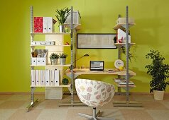 DIY shelving system with integrated desk made from metal rails and wooden panels in study
