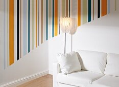 Multicoloured striped areas on walls in corner of living room