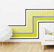Wall decorated with horizontal and vertical strips of wallpaper