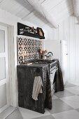 Kitchen counter clad in wood in Scandinavian log cabin