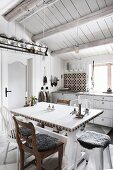 Vintage kitchen with dining area in Scandinavian log cabin