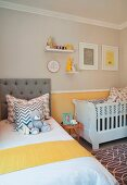 Scatter cushions and teddy on bed and cot in nursery