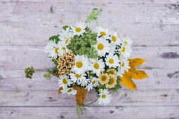Bouquet with ox-eye daisies and yarrow