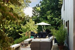 Modern outdoor furniture on terrace in garden