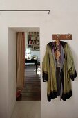 Kimono hung from coat rack next to open doorway