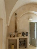 Vintage lanterns on masonry tables in Apulian trullo