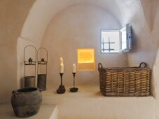 Rustically decorated arched niche with small window in restored Apulian trullo