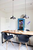 Designer chairs in industrial-style dining room