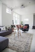 Long-pile rugs and designer furniture in living room