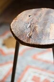 Vintage stool with round wooden seat