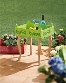 DIY tray table made from old fruit crate painted lime green