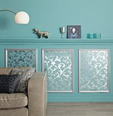 Elegant wall design: moulded dado rail and panelling hand-made from patterned wallpaper and moulding strips
