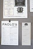 Various menus stuck on wall