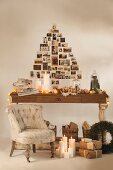 Festively decorated wooden table, Christmas presents on floor and Christmas-tree shape made from nostalgic photos on wall