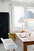 Wooden dining table and shell chairs