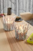 Tea lights decorated with birch twigs