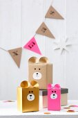 Various Christmas gift boxes with bear motifs