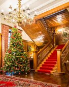 Opulent Christmas tree in grand hall