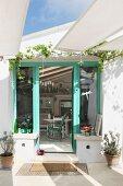 View into Mediterranean house through French windows