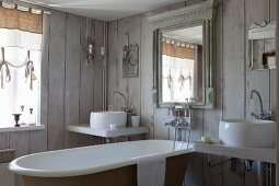 Vintage-style bathroom with board walls