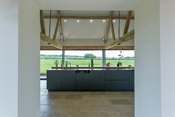 Breakfast bar and glass wall in modern kitchen