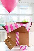 Balloon, gift voucher and open box