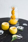 Hand-made lemon candle holders and confetti decorating table