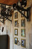 Gallery of framed vintage photos below renovated mechanical element on concrete wall