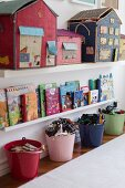 Shelves and colourful buckets organising various items in child's bedroom