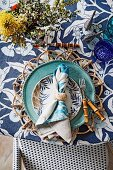Shades of blue and various floral patterns on a laid table with a maritime flair