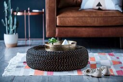 Homemade coffee table made from old tires and rope
