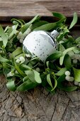 Wreath of mistletoe around Christmas tree bauble