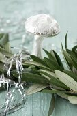Garland of olive branches and glass mushroom ornament