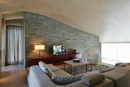 Elegant lounge with stone wall under curving ceiling