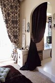 Dark velvet curtain in arched doorway
