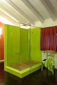 Lime-green shower on platform in modern bathroom