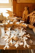 Elaborate cuckoo clock and other carvings on workbench